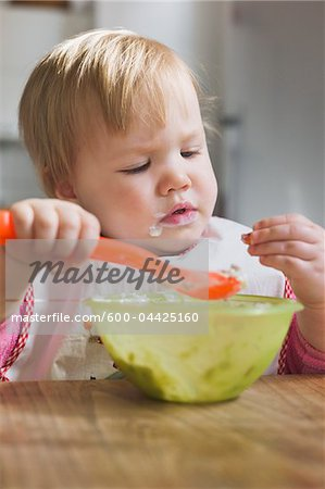 Baby Girl Eating from Bowl Stock Photo - Premium Royalty-Free, Image code: 600-04425160
