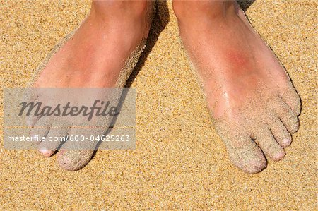 Feet in Sand Stock Photo - Premium Royalty-Free, Image code: 600-04625263