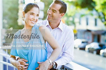 Couple on Balcony Stock Photo - Premium Royalty-Free, Image code: 600-04625298