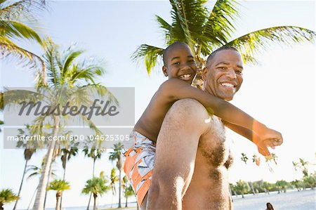 Father and Son at Beach Stock Photo - Premium Royalty-Free, Image code: 600-04625305