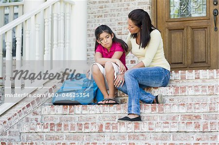 Mother and Daughter on Steps Stock Photo - Premium Royalty-Free, Image code: 600-04625354