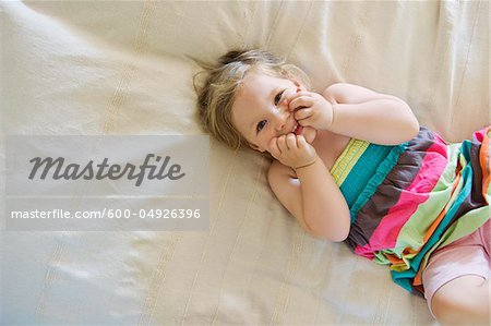 Young Girl Lying in Bed, Sweden Stock Photo - Premium Royalty-Free, Image code: 600-04926396