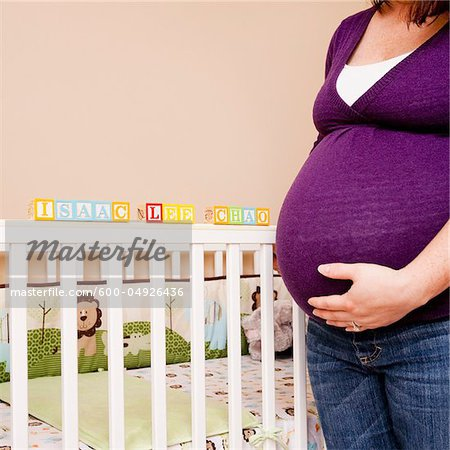 Pregnant Woman Standing next to Crib Stock Photo - Premium Royalty-Free, Image code: 600-04926436