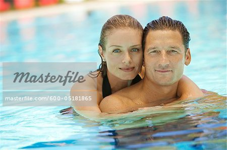 Portrait of Couple in Pool, Palm Beach Gardens, Florida, USA Stock Photo - Premium Royalty-Free, Image code: 600-05181865
