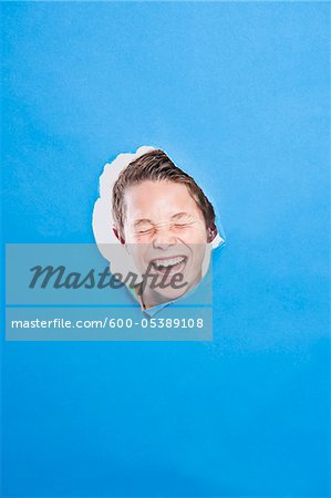 Boy Looking Through Hole Stock Photo - Premium Royalty-Free, Image code: 600-05389108