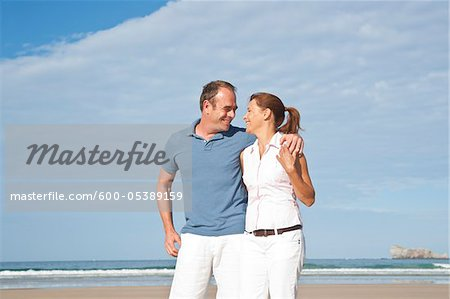Couple on Beach, Camaret-sur-Mer, Finistere, Bretagne, France Stock Photo - Premium Royalty-Free, Image code: 600-05389159