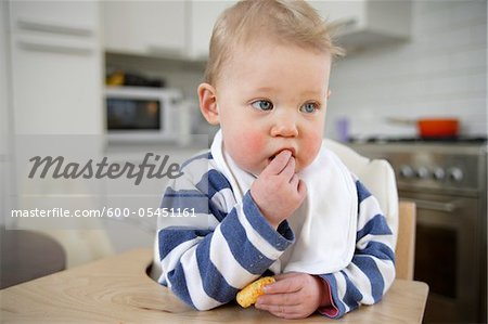 Portrait of Baby Girl Eating, London, England Stock Photo - Premium Royalty-Free, Image code: 600-05451161