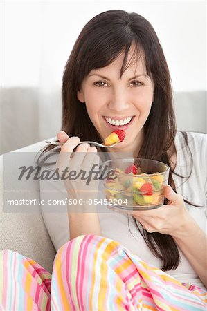 Close-up of Woman Eating Bowl of Fruit Stock Photo - Premium Royalty-Free, Image code: 600-05452204