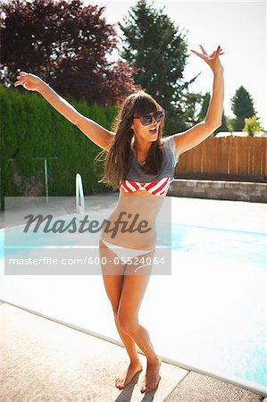 Woman Dancing by Pool, Vancouver, Washington, USA Stock Photo - Premium Royalty-Free, Image code: 600-05524064