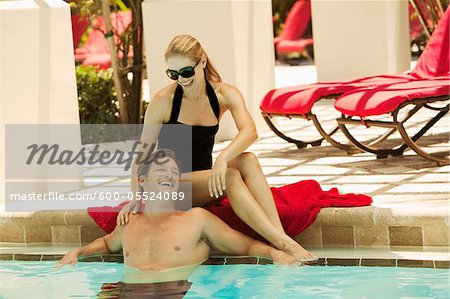 Couple at Swimming Pool Stock Photo - Premium Royalty-Free, Image code: 600-05524089
