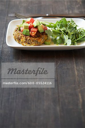 Lentil Patty with Avocado, Tomato, and Arugula Stock Photo - Premium Royalty-Free, Image code: 600-05524116