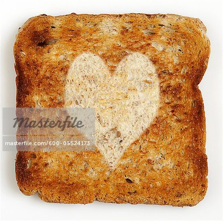 Slice of Toast with Heart Shape Stock Photo - Premium Royalty-Free, Image code: 600-05524173