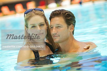 Portrait of Couple in Swimming Pool Stock Photo - Premium Royalty-Free, Image code: 600-05524472