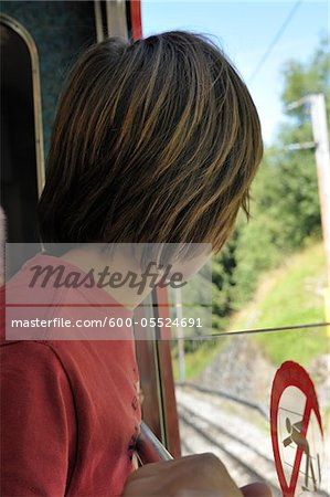 Back View of Boy on Train, Alps, France Stock Photo - Premium Royalty-Free, Image code: 600-05524691