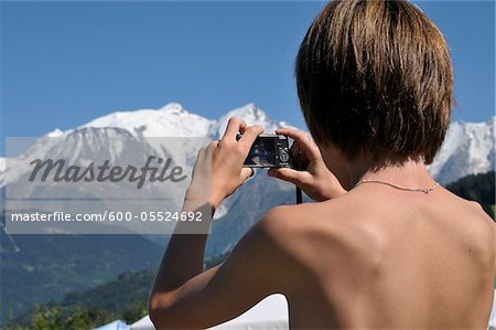 Back View of Boy taking Picture of Mountains, Alps, France Stock Photo - Premium Royalty-Free, Image code: 600-05524692