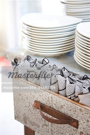 Plates and Napkin Wrapped Cutlery, Ontario, Canada Stock Photo - Premium Royalty-Free, Image code: 600-05602739