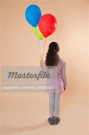 Girl Holding Balloons Stock Photo - Premium Royalty-Free, Image code: 600-05653063