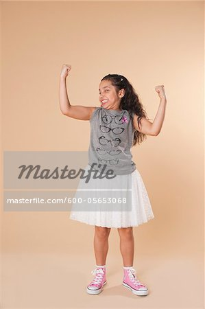 Portrait of Girl Flexing Arms Stock Photo - Premium Royalty-Free, Image code: 600-05653068