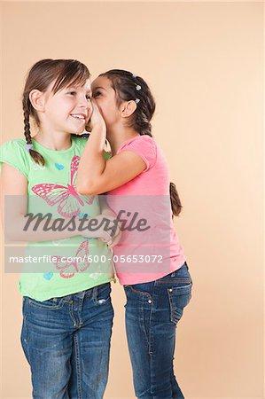 Portrait of Girls Whispering