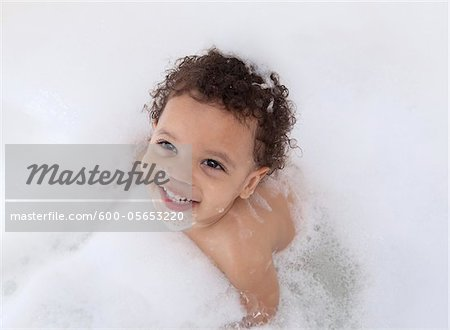 Boy in Bubble Bath Stock Photo - Premium Royalty-Free, Image code: 600-05653220