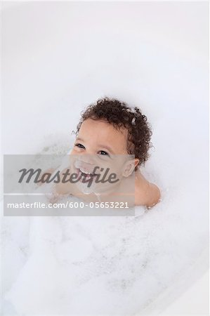Boy in Bubble Bath Stock Photo - Premium Royalty-Free, Image code: 600-05653221