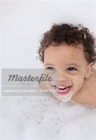 Boy in Bubble Bath Stock Photo - Premium Royalty-Free, Image code: 600-05653222