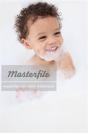 Boy in Bubble Bath Stock Photo - Premium Royalty-Free, Image code: 600-05653224