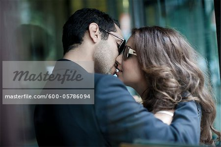 Couple Kissing Stock Photo - Premium Royalty-Free, Image code: 600-05786094