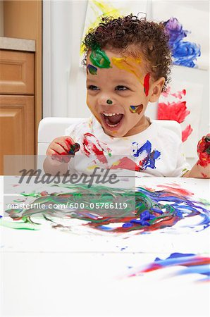 Little Boy Finger Painting Stock Photo - Premium Royalty-Free, Image code: 600-05786119