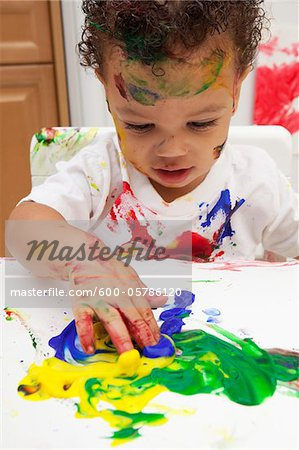 messy toddler fingerpainting Stock Photo - Premium Royalty-Free, Image code: 600-05786120