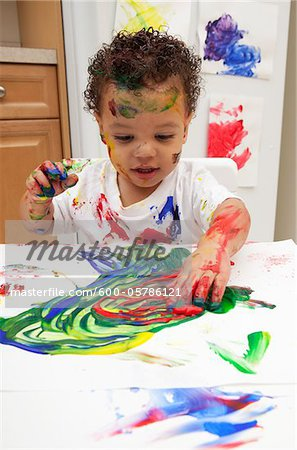 Little Boy Finger Painting Stock Photo - Premium Royalty-Free, Image code: 600-05786121