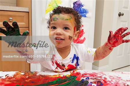 Little Boy Finger Painting Stock Photo - Premium Royalty-Free, Image code: 600-05786122