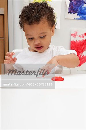 Little Boy Finger Painting Stock Photo - Premium Royalty-Free, Image code: 600-05786123