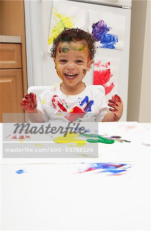 Little Boy Finger Painting Stock Photo - Premium Royalty-Free, Image code: 600-05786124