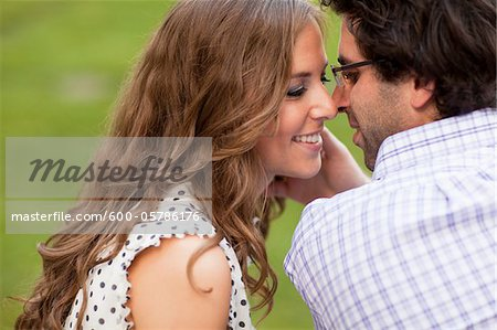 Close-up of Young Couple Kissing in Park Stock Photo - Premium Royalty-Free, Image code: 600-05786176