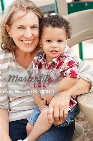 Portrait of Young Boy and Grandmother at Playground Stock Photo - Premium Royalty-Free, Image code: 600-05786424