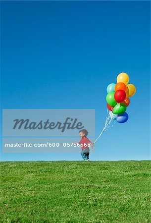Boy with Balloons Stock Photo - Premium Royalty-Free, Image code: 600-05786568