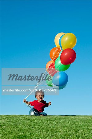 Crying Boy with Balloons Stock Photo - Premium Royalty-Free, Image code: 600-05786569