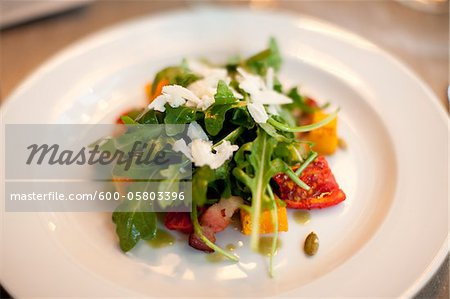 Close-up of Arugula Salad on Plate Stock Photo - Premium Royalty-Free, Image code: 600-05803396