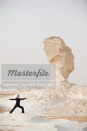 Woman Practicing Yoga, White Desert, Farafra, New Valley Governorate, Egypt Stock Photo - Premium Royalty-Free, Image code: 600-05822103