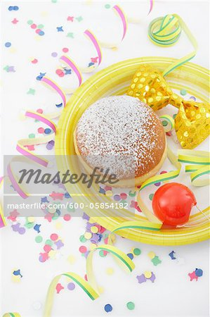 Doughnut, Bow Tie and Clown Nose Stock Photo - Premium Royalty-Free, Image code: 600-05854182