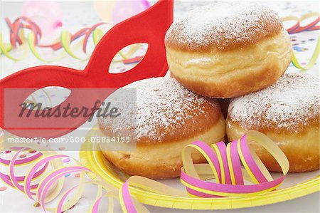 Doughnuts on Paper Plate, Mask and Streamers Stock Photo - Premium Royalty-Free, Image code: 600-05854199
