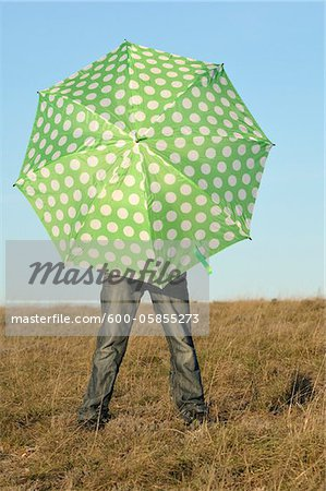 Boy with Umbrella in Field, Rogues, France Stock Photo - Premium Royalty-Free, Image code: 600-05855273