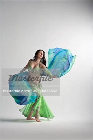 Woman Belly Dancing Stock Photo - Premium Royalty-Free, Image code: 600-05855332