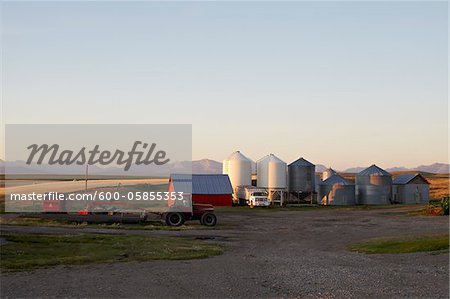 Farm with Barn, Tractors and Silos, Pincher Creek, Alberta, Canada Stock Photo - Premium Royalty-Free, Image code: 600-05855353