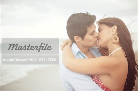 Couple Kissing at Beach, Jupiter, Palm Beach County, Florida, USA Stock Photo - Premium Royalty-Free, Image code: 600-05947639