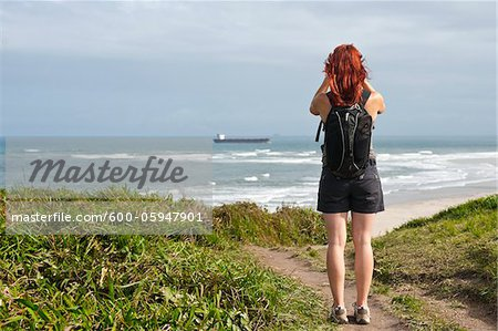Backview of Woman Hiking and Looking at View, Ilha do Mel, Parana, Brazil Stock Photo - Premium Royalty-Free, Image code: 600-05947901