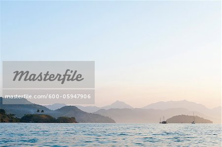 Scenic View of Mountains and Boats near Paraty, Costa Verde, Brazil Stock Photo - Premium Royalty-Free, Image code: 600-05947906
