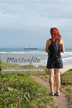 Backview of Woman Hiking and Looking at View, Ilha do Mel, Parana, Brazil Stock Photo - Premium Royalty-Free, Image code: 600-05947910