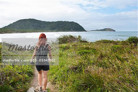 Backview of Woman Hiking, Ilha do Mel, Parana, Brazil Stock Photo - Premium Royalty-Free, Image code: 600-05947911